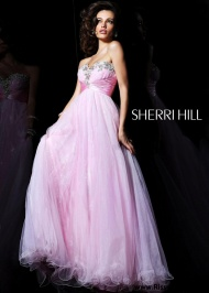 Stand out in this Sherri Hill a-line dress with beaded strapless neckline.Fabric: Beaded/TulleSherri Hill 21085 Strapless Pink Ball Gown  * Style: 21085  * Color: Pink  * Hemline: Long/Floor-Length  * Neckline: Strapless, Sweetheart  * Silhouette: Ball Gown  * Fabric: Tulle  * Embellishment: Beaded  * Sleeves: Sleeveless  * Strap Style: Strapless  http://www.promdressesqueen.com/strapless-long-pink-ball-dress-2015-by-sherri-hill-21085-p-645.html
