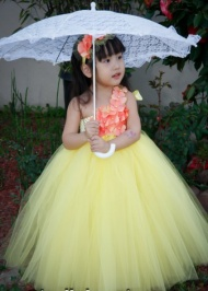 Beautiful and elegant yellow colored designer party wear tutu dress with one sided crochet bodice with matching flower headband is an ideal pick for children.